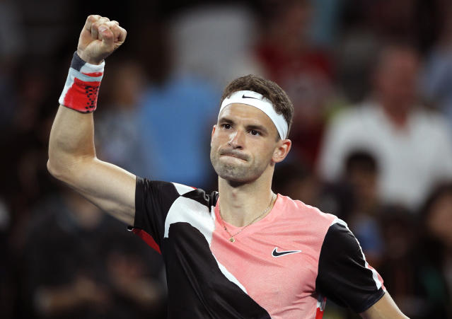 Bulgaria's Grigor Dimitrov celebrates after defeating Argentina's Juan Ignacio Londero in their first round singles match at the Australian Open tennis championship in Melbourne, Australia, Monday, Jan. 20, 2020. (AP Photo/Andy Wong)