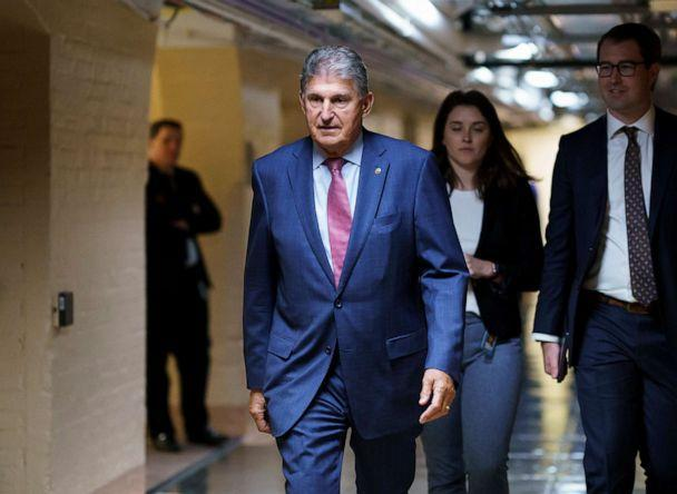 PHOTO: Sen. Joe Manchin walks to meet with Democratic members of the Texas legislature at the Capitol in Washington to discuss voting rights after the group left Austin to try kill a Republican bill that would make voting harder in Texas, July 15, 2021. (J. Scott Applewhite/AP, FILE)
