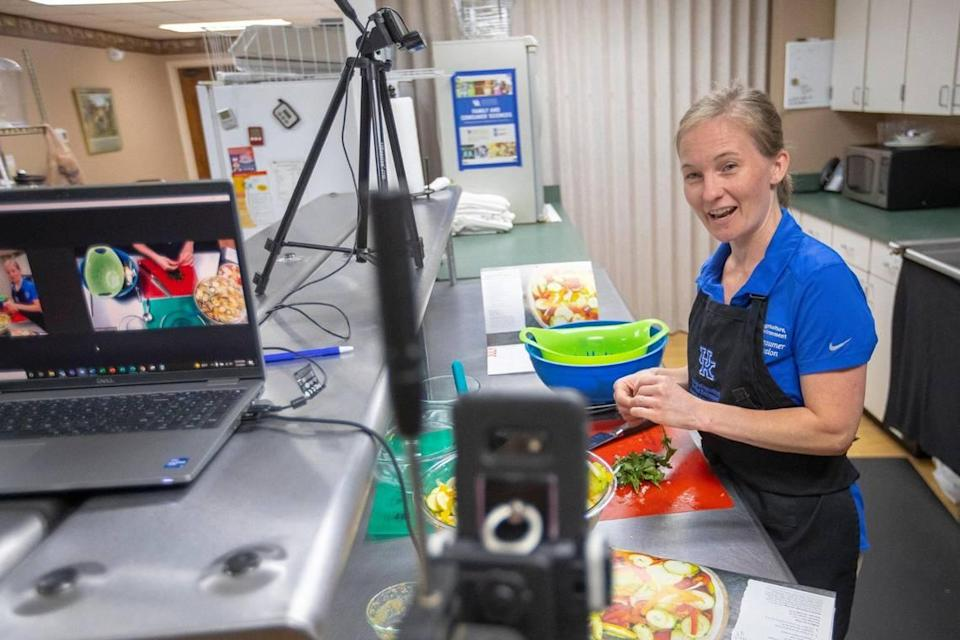 Woodford County Family & Consumer Sciences Extension Agent Elizabeth Coots uses two smartphones to livestream her preeraption of a recipe Wednesday, July 7, 2021 at the Woodford Co. Extension Office in Versailles.