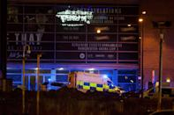 <p>A police van and an ambulance are seen outside the Manchester Arena, where U.S. singer Ariana Grande had been performing, in Manchester, northern England, Britain May 22, 2017. (Jon Super/Reuters) </p>
