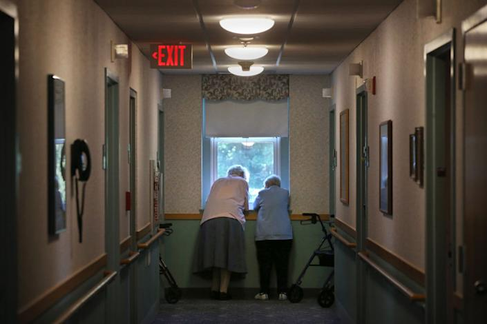 """Nursing homes and long-term care facility residents, like these women photographed in Marlborough, Mass., in August, are particularly vulnerable to COVID-19.<span class=""""copyright"""">Craig F. Walker—The Boston Globe/Getty Images</span>"""