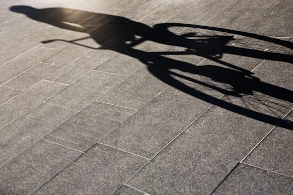 Shadow of a person riding a bike