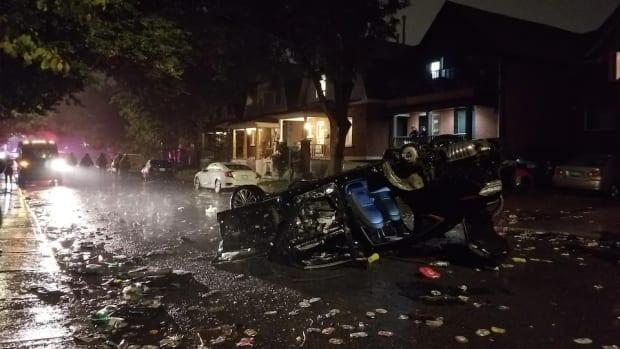 A vehicle was flipped by partygoers after Saturday's Panda Game football match. When officers arrived, Russell Avenue had been overrun. (Steve Higham - image credit)
