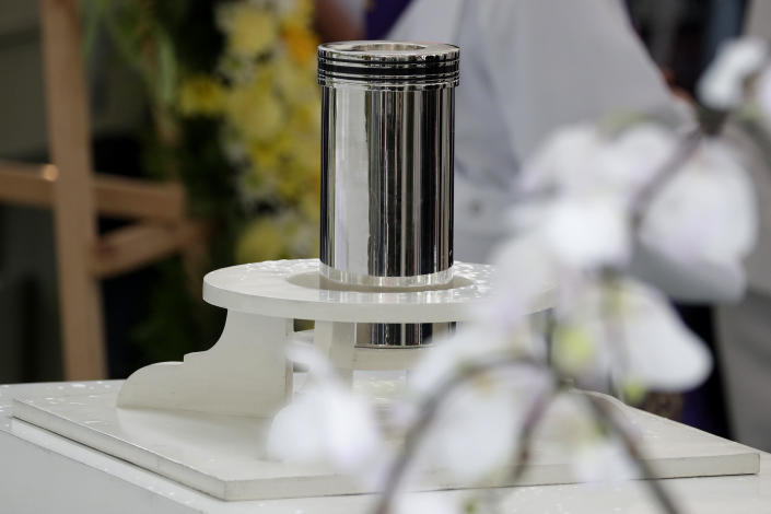 The urn of former Philippine President Benigno Aquino III is seen during state burial rites on Saturday, June 26, 2021 at a memorial park in suburban Paranaque city, Philippines. Aquino was buried in austere state rites during the pandemic Saturday with many remembering him for standing up to China over territorial disputes, striking a peace deal with Muslim guerrillas and defending democracy in a Southeast Asian nation where his parents helped topple a dictator. He was 61. (AP Photo/Aaron Favila)