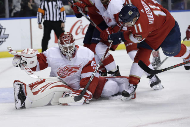 Detroit Red Wings goaltender Jonathan Bernier, left, makes a save on a shot by Florida Panthers center Jonathan Huberdeau (11) during the second period of an NHL hockey game Saturday, Nov. 2, 2019, in Sunrise, Fla. (AP Photo/Lynne Sladky)