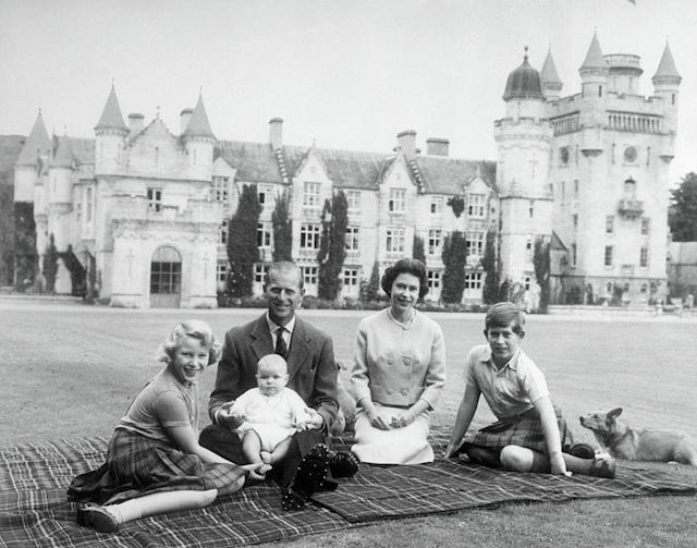 <p>The current Queen of the United Kingdom had two of her four children — Prince Andrew and Prince Edward — during her reign. She is seen here on the grounds of Balmoral Castle with Prince Charles, Princess Anne, and Prince Philip, who holds baby Prince Andrew on his lap. (Photo: Getty Images) </p>