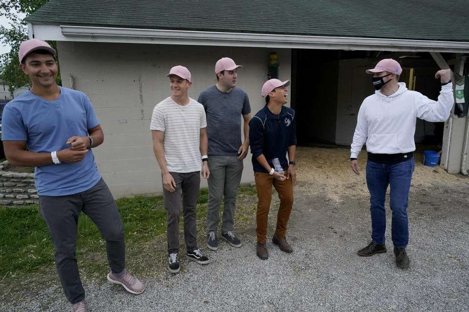 Former college teammates from left to right, Dan Giovacchini, Reiley Higgins, Alex Quoyeser, Patrick O'Neill and Eric Armagost, stand outside the barn housing Kentucky Derby entrant Hot Rod Charlie before a workout at Churchill Downs Wednesday, April 28, 2021, in Louisville, Ky. The group owns 25% of the horse being trained by O'Neill's uncle Doug O'Neill. (AP Photo/Charlie Riedel)