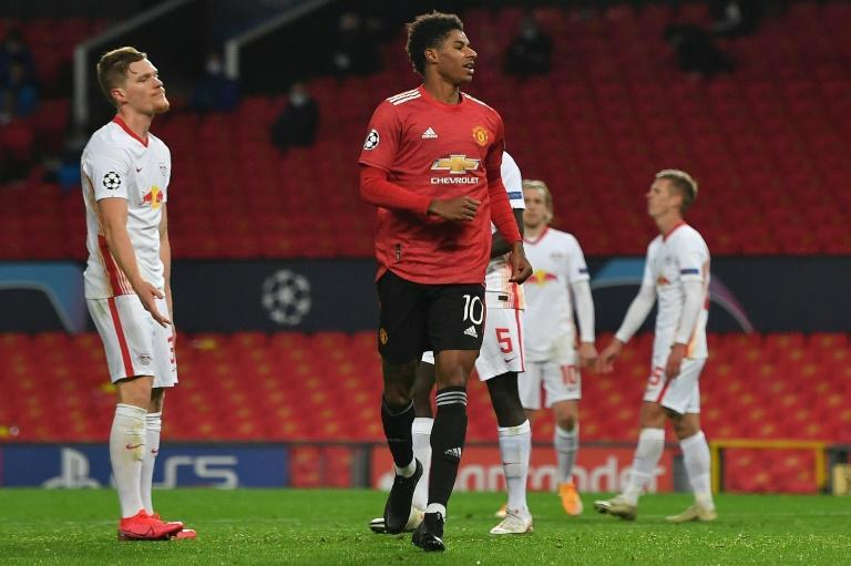 Marcus Rashford celebrates scoring his third goal and Manchester United's fifth in their big win over RB Leipzig