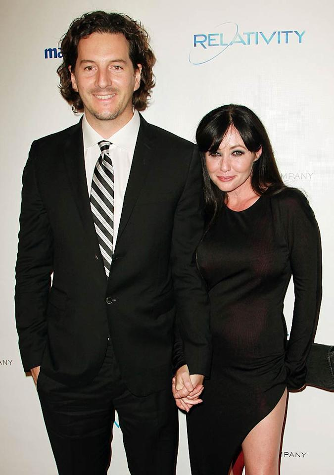 "Well, it didn't work out twice before for ""Beverly Hills, 90210"" actress Shannen Doherty, but that didn't stop her from tying the knot for a third time with Kurt Iswarienko in Malibu, California, on October 15. Sounds like this one could have the potential to last though! The brunette with the bad girl reputation said she was entering into the union more cautiously: ""Marriage to me is such a gigantic commitment that it's not something I'd ever go into lightly anymore,"" she revealed to <i>People</i>. ""I've learned my lesson."""