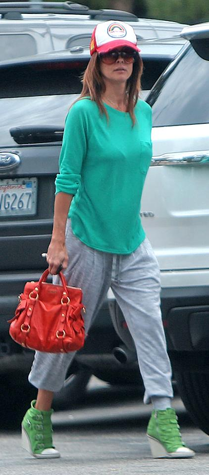 **EXCLUSIVE** Brooke Burke Charvet steps out in some sky-high green athletic wedges while running errands with a friend in Malibu