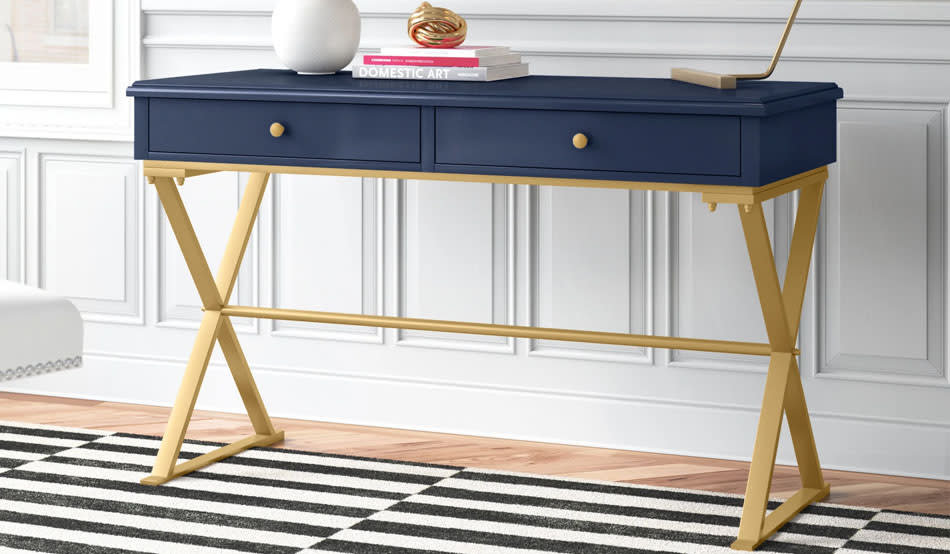 This elegant desk is sturdy and filled with compartments. (Photo: Wayfair)