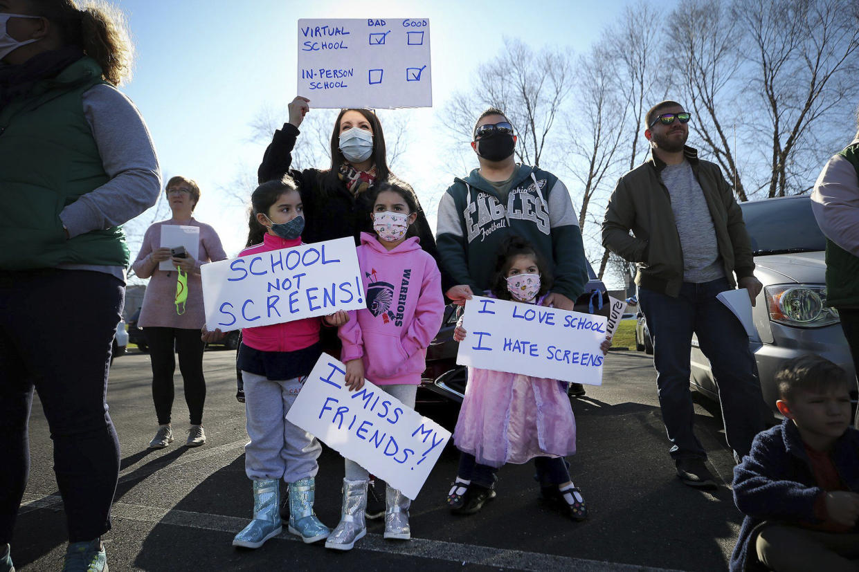 Families rally to reopen schools