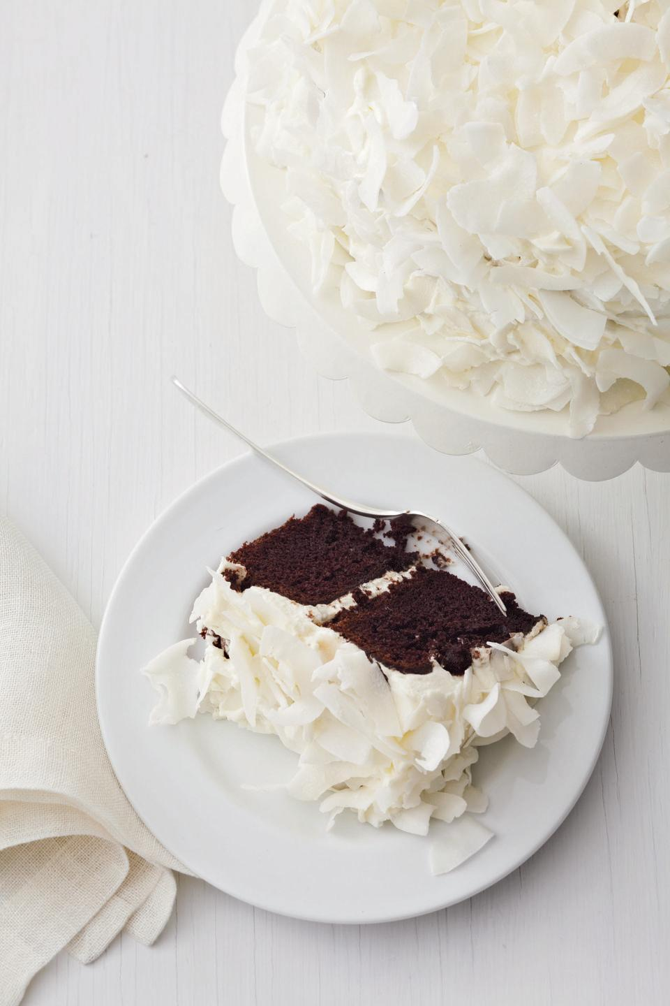 """<p>Sweet and tangy sour cream frosting tops off moist and light chocolate cake for the sweetest ending to your fun-filled Fourth.</p><p><em><a href=""""https://www.goodhousekeeping.com/food-recipes/a13382/chocolate-cake-coconut-cream-recipe-122804/"""" rel=""""nofollow noopener"""" target=""""_blank"""" data-ylk=""""slk:Get the recipe for Chocolate Cake with Coconut Cream »"""" class=""""link rapid-noclick-resp"""">Get the recipe for Chocolate Cake with Coconut Cream »</a></em></p>"""
