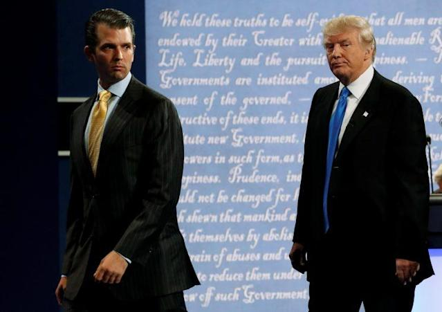 Donald Trump Jr. walks offstage with his father, Donald Trump, after a presidential debate at Hofstra University on Sept. 26, 2016. (Photo: Brian Snyder/Reuters)
