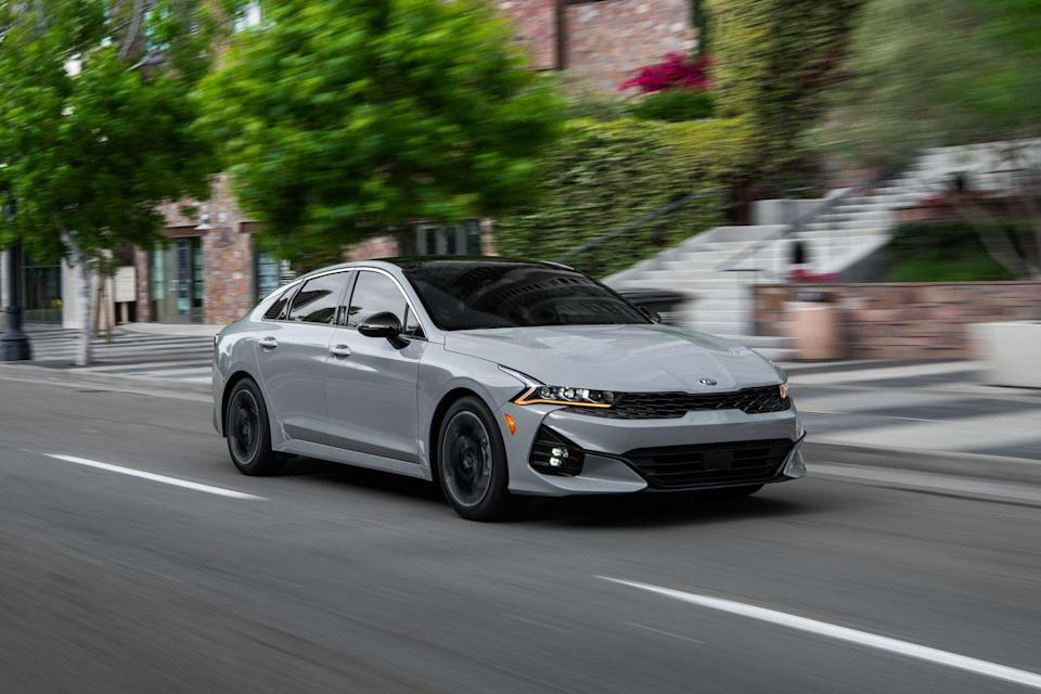 "<p>Even with the dwindling desirability of family sedans, <a href=""https://www.caranddriver.com/kia"" rel=""nofollow noopener"" target=""_blank"" data-ylk=""slk:Kia"" class=""link rapid-noclick-resp"">Kia</a> has crafted a compelling example with the <a href=""https://www.caranddriver.com/kia/k5"" rel=""nofollow noopener"" target=""_blank"" data-ylk=""slk:all-new 2021 K5"" class=""link rapid-noclick-resp"">all-new 2021 K5</a>. Its daring design evokes sportiness and luxuriousness, and the sleek-looking four-door is a legitimate head-turner. The cabin is elegantly appointed and brimming with high-tech content, such as a digital gauge cluster and cool ambient lighting. While the K5 isn't particularly entertaining to drive, its powertrain and ride provide a refined experience. The 290-hp GT model comes with performance equipment that should give it a more entertaining attitude. A spacious back seat and generous trunk also make it a useful alternative to popular <a href=""https://www.caranddriver.com/features/g27257734/best-suvs/"" rel=""nofollow noopener"" target=""_blank"" data-ylk=""slk:crossover SUVs"" class=""link rapid-noclick-resp"">crossover SUVs</a>, especially with its optional all-wheel-drive system. The death of the mid-size <a href=""https://www.caranddriver.com/features/g27227136/best-sedans/"" rel=""nofollow noopener"" target=""_blank"" data-ylk=""slk:sedan"" class=""link rapid-noclick-resp"">sedan</a> may be imminent, but the 2021 K5 aims to be one of the best left.</p><p><a class=""link rapid-noclick-resp"" href=""https://www.caranddriver.com/kia/k5"" rel=""nofollow noopener"" target=""_blank"" data-ylk=""slk:Review, Pricing, and Specs"">Review, Pricing, and Specs</a></p>"