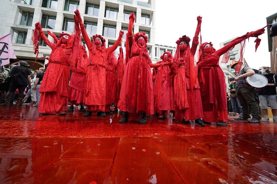 Members of Extinction Rebellion dance in fake blood in Paternoster Square in the City of London (Kirsty O'Connor/PA) (PA Wire)