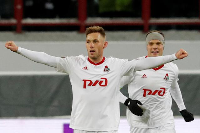 Soccer Football - Europa League Round of 16 Second Leg - Lokomotiv Moscow vs Atletico Madrid - RZD Arena, Moscow, Russia - March 15, 2018 Lokomotiv Moscow's Maciej Rybus celebrates scoring their first goal REUTERS/Sergei Karpukhin