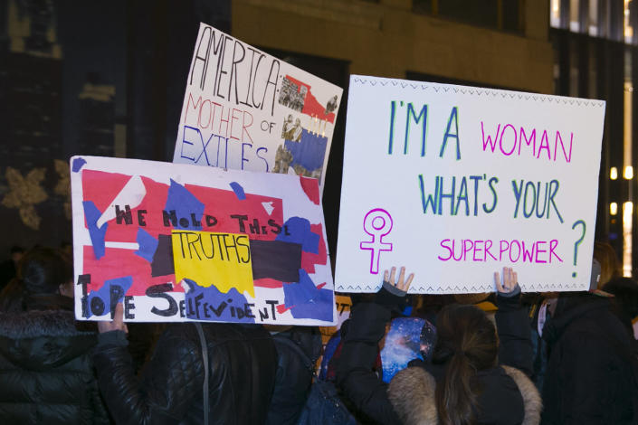 <p>Participants in the Women's March outside Trump Tower hold signs to protest President Donald J. Trump and his proposed policies in New York City on Jan. 21, 2017. (Photo: Gordon Donovan/Yahoo News) </p>