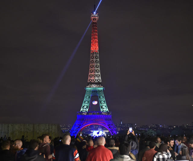<p>The Eiffel Tower in Paris, France, shines in the colors of a rainbow to honor victims of Sunday's mass shooting at an Orlando gay club, Monday, June 13, 2016. (AP Photo/Martin Meissner) </p>