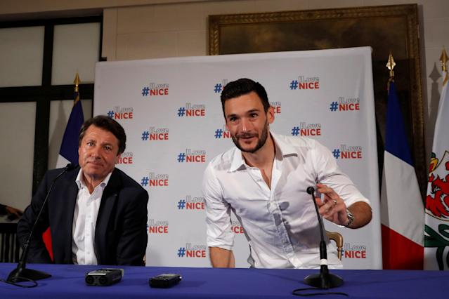 France soccer team goalkeeper Hugo Lloris sits next to Christian Estrosi, Mayor of Nice, as he arrives to attend a news conference at the city hall, after their victory in the 2018 Russia Soccer World Cup, in Nice, France, July 18, 2018. REUTERS/Eric Gaillard