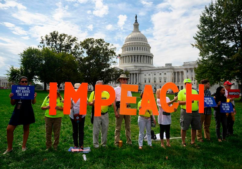 Protesters in front of the U.S. Capitol in Washington, D.C., on Sept. 26, 2019.
