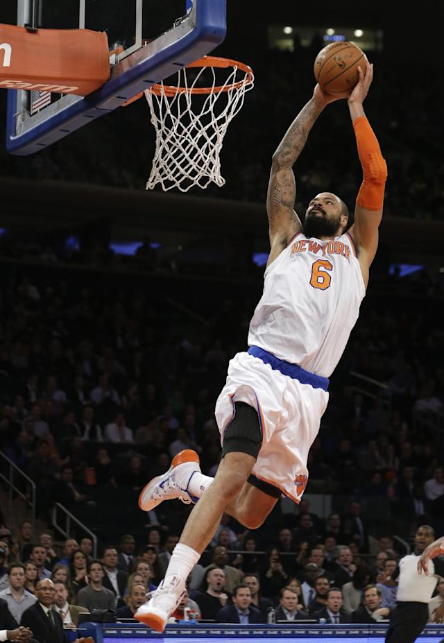 New York Knicks' Tyson Chandler (6) dunks the ball during the first half of an NBA basketball game against the Sacramento Kings on Wednesday, Feb. 12, 2014, in New York. (AP Photo/Frank Franklin II)