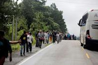 Honduran migrants try to hitchhike to get into the Agua Caliente border and hoping to cross into Guatemala and join a caravan trying to reach the U.S, in the municipality of Ocotepeque, Honduras October 17, 2018. REUTERS/Jorge Cabrera