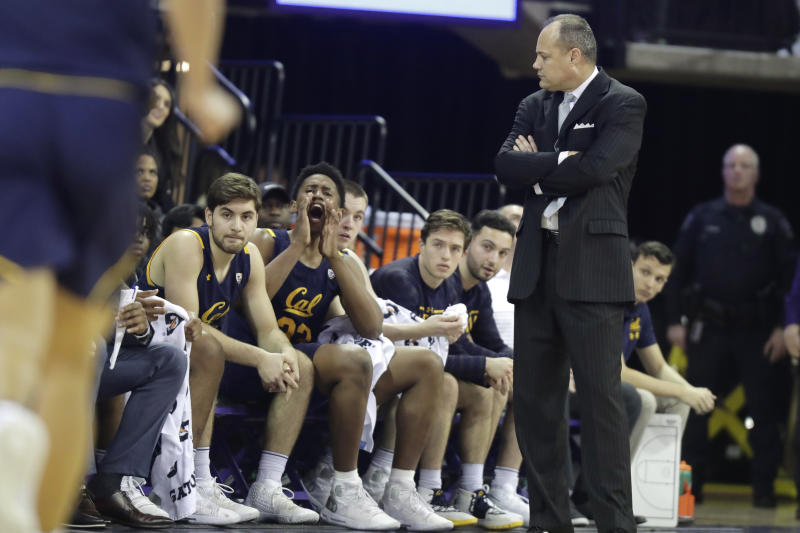 California coach Mark Fox, right, looks toward the bench during the first half of the team's NCAA college basketball game against Washington, Saturday, Feb. 22, 2020, in Seattle. (AP Photo/Ted S. Warren)
