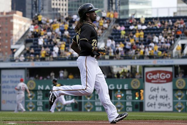 Pittsburgh Pirates' Andrew McCutchen scores on a double by Pedro Alvarez off St. Louis Cardinals starting pitcher Lance Lynn during the first inning of a baseball game in Pittsburgh on Tuesday, July 30, 2013. (AP Photo/Gene J. Puskar)