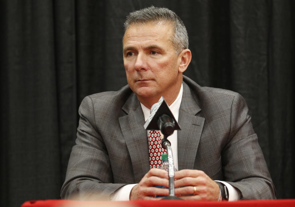 """Urban Meyer, who was suspended to start the season amid an investigation into allegations of illegal and illicit behavior by an assistants, will teach a """"character and leadership"""" class at Ohio State. (AP Photo/Jay LaPrete)"""