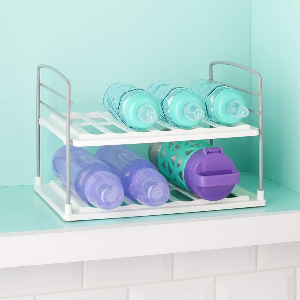"""<p>Stop bottles from rolling around your cabinets with this <a href=""""https://www.popsugar.com/buy/YouCopia-UpSpace-Water-Bottle-Organizer-538646?p_name=YouCopia%20UpSpace%20Water%20Bottle%20Organizer&retailer=amazon.com&pid=538646&price=17&evar1=casa%3Aus&evar9=47087273&evar98=https%3A%2F%2Fwww.popsugar.com%2Fhome%2Fphoto-gallery%2F47087273%2Fimage%2F47089326%2FYouCopia-UpSpace-Water-Bottle-Organizer&list1=shopping%2Corganization%2Chome%20organization&prop13=mobile&pdata=1"""" rel=""""nofollow"""" data-shoppable-link=""""1"""" target=""""_blank"""" class=""""ga-track"""" data-ga-category=""""Related"""" data-ga-label=""""https://www.amazon.com/YouCopia-50185-UpSpace-Bottle-Organizer/dp/B07T1JH79J?ref_=ast_sto_dp&amp;th=1&amp;psc=1"""" data-ga-action=""""In-Line Links"""">YouCopia UpSpace Water Bottle Organizer</a> ($17).</p>"""