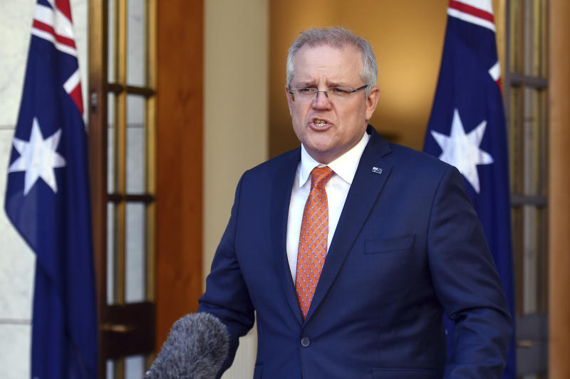 Australian Prime Minister Scott Morrison speaks at a press conference at Parliament House in Canberra, Thursday, July 9, 2020. Australia suspended its extradition treaty with Hong Kong and extended visas for Hong Kong residents in response to China's imposition of a tough national security law on the semi-autonomous territory, the prime minister said. (Mick Tsikas/AAP Image via AP)
