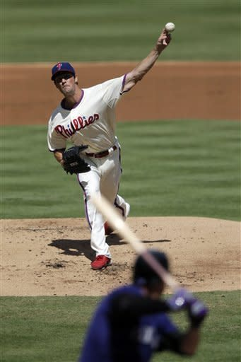 Philadelphia Phillies' Cole Hamels pitches against Colorado Rockies' Andrew Brown in the second inning of the first game of a baseball doubleheader on Sunday, Sept. 9, 2012, in Philadelphia. (AP Photo/Matt Slocum)