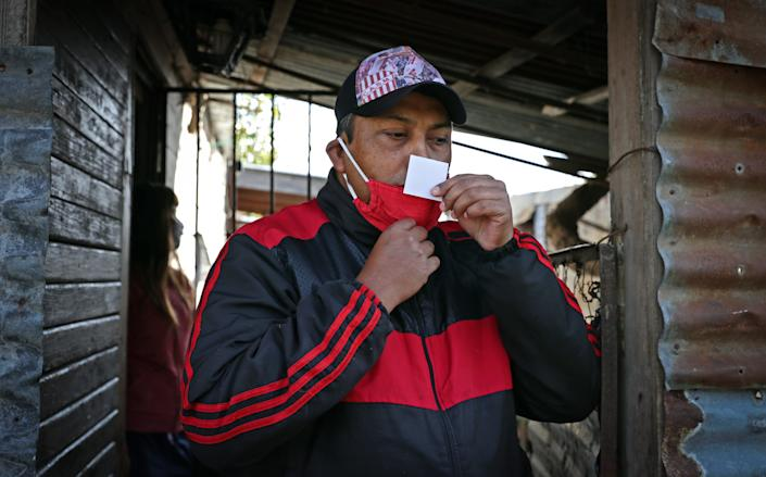 On May 24, 2020, a resident of Altos de San Lorenzo, Argentina, undergoes an olfactory test to control odor loss.