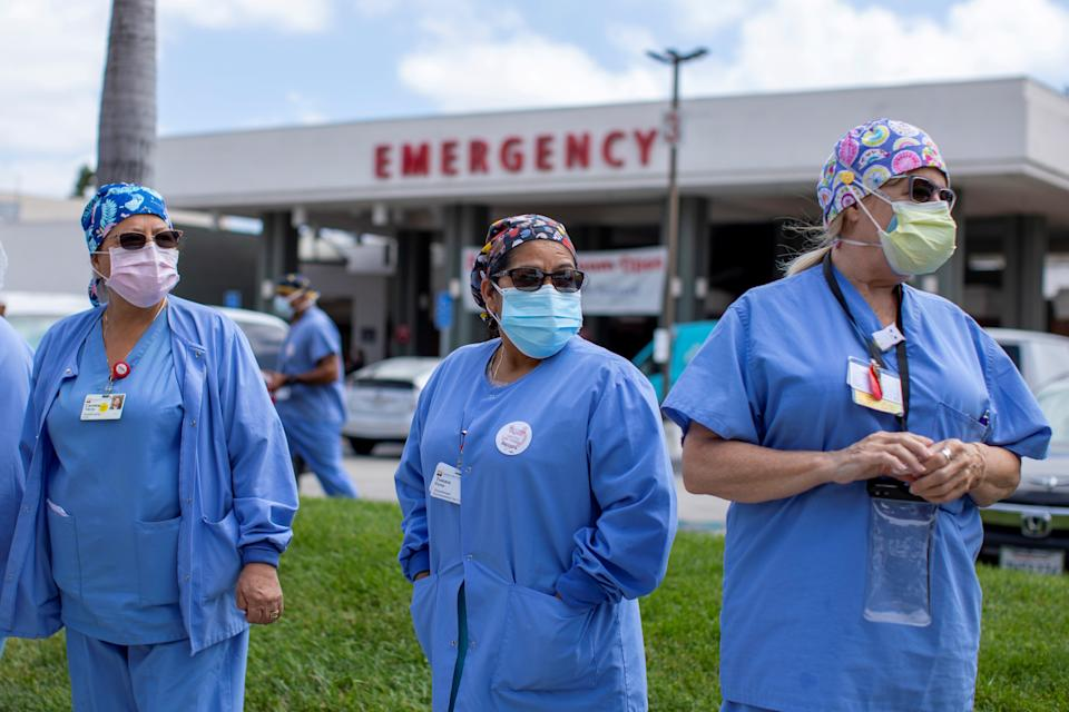 Healthcare workers at Fountain Valley Regional Hospital hold a rally outside their hospital for safer working conditions during the outbreak of the coronavirus disease (COVID-19) in Fountain Valley, California, U.S., August 6, 2020. REUTERS/Mike Blake     TPX IMAGES OF THE DAY