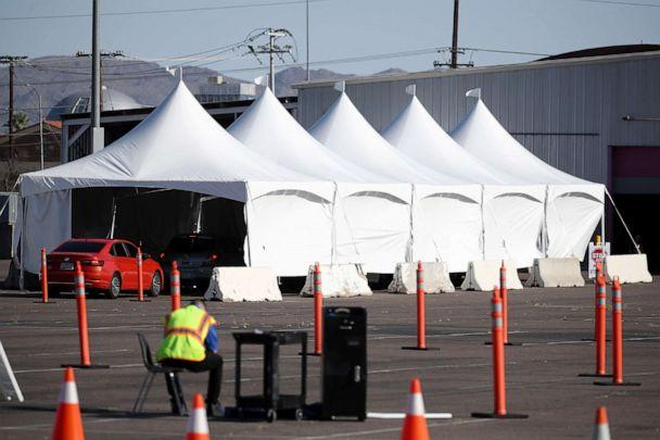PHOTO: Cars line up as they prepare for coronavirus (COVID-19) testing at a site erected near the Arizona Veterans Memorial Arena, April 27, 2020, in Phoenix. (Christian Petersen/Getty Images, FILE)