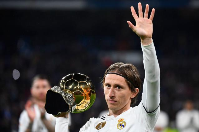 Luka Modric didn't seem happy that Cristiano Ronaldo and Lionel Messi decided to skip the Ballon d'Or ceremony. (Goal.com)