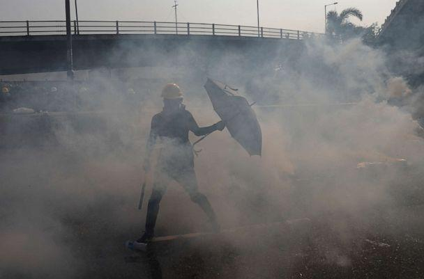 PHOTO: Tear gas floats in the air as demonstrators clash with riot police during a protest at Kowloon Bay in Hong Kong, China, August 24, 2019. (Tyrone Siu/Reuters)