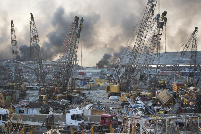 FILE - Aftermath of a massive explosion is seen in in Beirut, Lebanon, Tuesday, Aug. 4, 2020. The lead judge investigating the massive blast in Beirut's port suspended his work in the case Monday, Sept. 27, 2021 after he was informed that a former Cabinet minister had submitted a request to recuse him. Judge Tarek Bitar, the second judge to lead the complicated and thorny investigation, cancelled the questioning of a former military intelligence general, scheduled for Monday. The Court of Appeals now has to decide whether to dismiss him from the case or not. (AP Photo/Hassan Ammar, file)