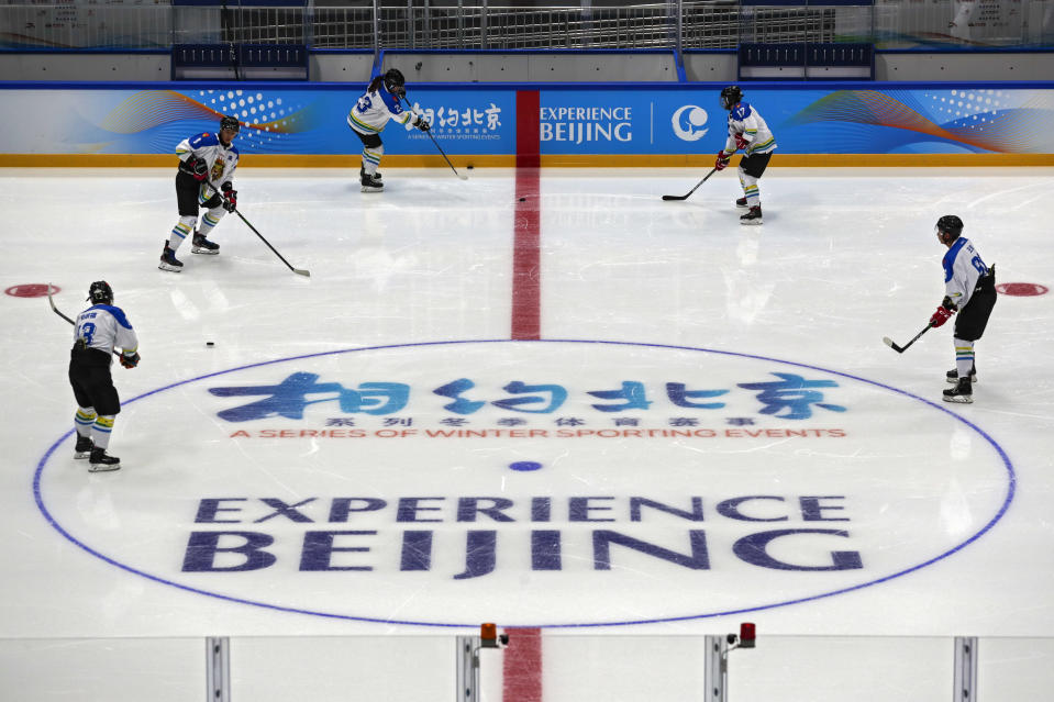 Capital Institute hockey team players practice at the ice hockey venue for the 2022 Beijing Winter Olympics during a test event at the National Indoor Stadium in Beijing, Thursday, April 1, 2021. Chinese capital holds 10 days test events for 2022 Beijing Winter Olympics in five different venues from April 1-10 and becomes the first city to hold both the Winter and Summer Olympics. (AP Photo/Andy Wong)