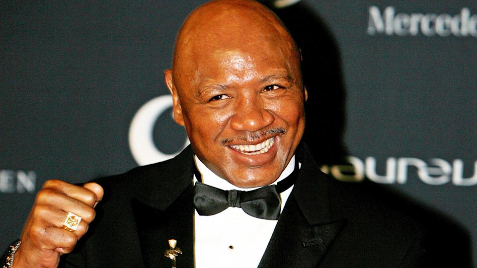 Boxing Hall of Famer Marvin Hagler is seen here posing for a photo at an event.