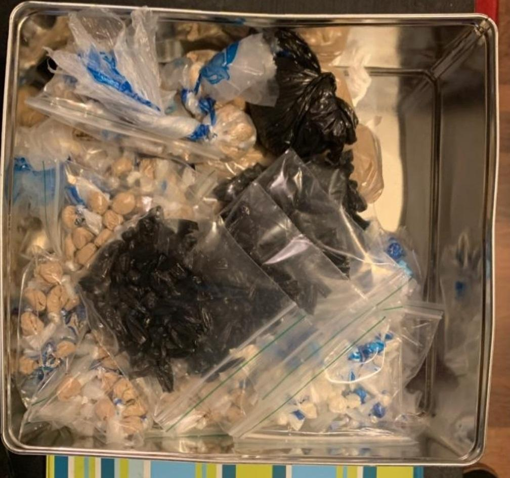 A tin was discovered in a bedroom wardrobe that contained wraps of heroine to the estimated value of £43,000, as well as white rocks that tested positive as crack cocaine (GMP)