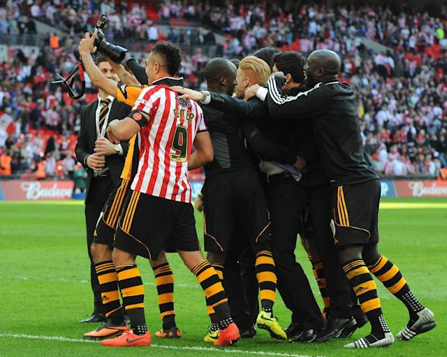 Hull City players take a selfie during celebrations after they beat Sheffield United 5-3 at the English FA Cup semifinal soccer match between Hull City and Sheffield United at Wembley Stadium, London, England, Sunday, April 13, 2014. (AP Photo/Rui Vieira)