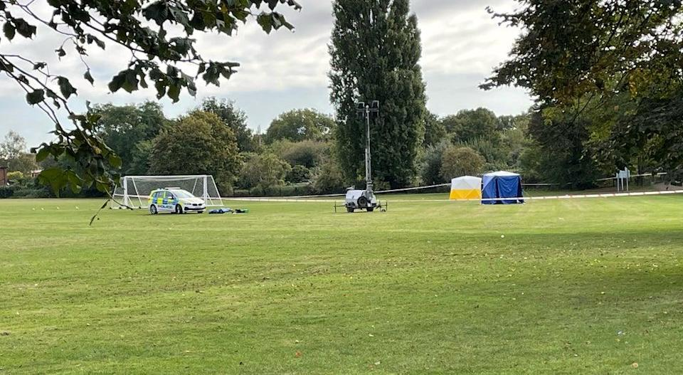 A police car and forensic tents at the scene on a playing field in Craneford Way, Twickenham, south-west London (Sophie Wingate/PA) (PA Wire)