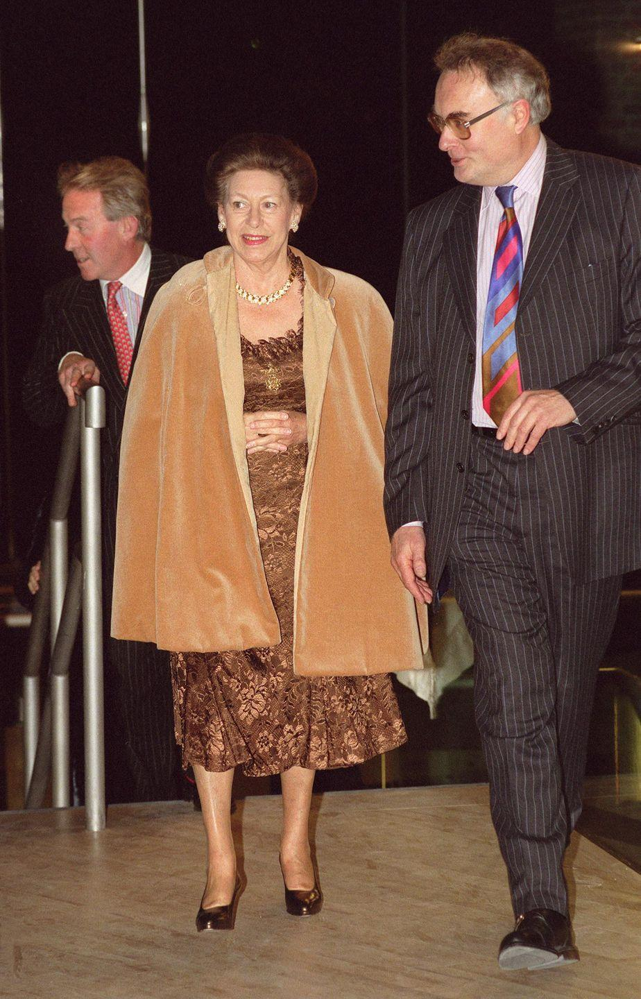 <p>Princess Margaret wore a look reminiscent of Pocahontas's for an evening at the Royal Ballet in 1998. The Queen's younger sister wore a brown brocade mid-length dress and covered up with a camel coat. </p>