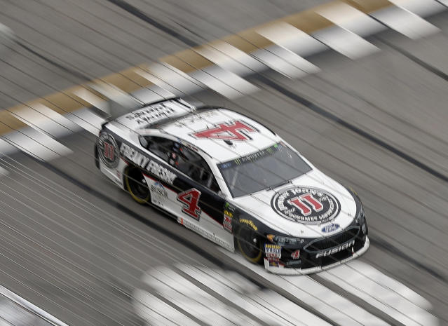 "<a class=""link rapid-noclick-resp"" href=""/nascar/sprint/drivers/205/"" data-ylk=""slk:Kevin Harvick"">Kevin Harvick</a> (4) crosses the start finish line during the NASCAR Cup Series auto race at Atlanta Motor Speedway in Hampton, Ga., on Sunday, Feb. 25, 2018. (AP Photo/Paul Abell)"