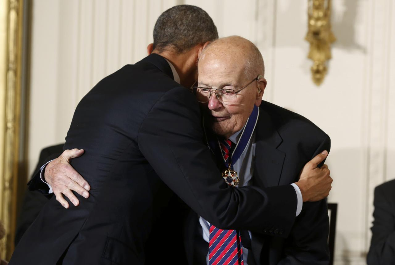 U.S. President Barack Obama (R) embraces U.S. Rep. John Dingell,  the longest serving Member of Congress in American history, after presenting him with the  the Presidential Medal of Freedom during a White House ceremony in Washington, November 24, 2014. The Presidential Medal of Freedom is the Nation's highest civilian honor, presented to individuals who have made especially meritorious contributions to the security or national interests of the United States, to world peace, or to cultural or other significant public or private endeavors.   REUTERS/Larry Downing (UNITED STATES  - Tags: POLITICS ENTERTAINMENT SOCIETY)