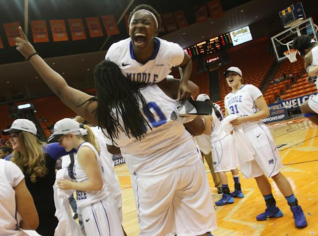 Shanice Cason gets a ride on Janiece's Johnson's shoulder as they celebrate their Conference USA Tournament victory in their NCAA Conference USA tournament championship basketball game Saturday, March 15, 2014 in El Paso, Texas. (AP Photo/Victor Calzada)