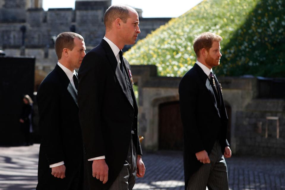 Britain's Prince William, Duke of Cambridge (C) and Britain's Prince Harry, Duke of Sussex, (R) follow the coffin during the ceremonial funeral procession of Britain's Prince Philip, Duke of Edinburgh to St George's Chapel in Windsor Castle in Windsor, west of London, on April 17, 2021. - Philip, who was married to Queen Elizabeth II for 73 years, died on April 9 aged 99 just weeks after a month-long stay in hospital for treatment to a heart condition and an infection. (Photo by Alastair Grant / various sources / AFP) (Photo by ALASTAIR GRANT/AFP via Getty Images)
