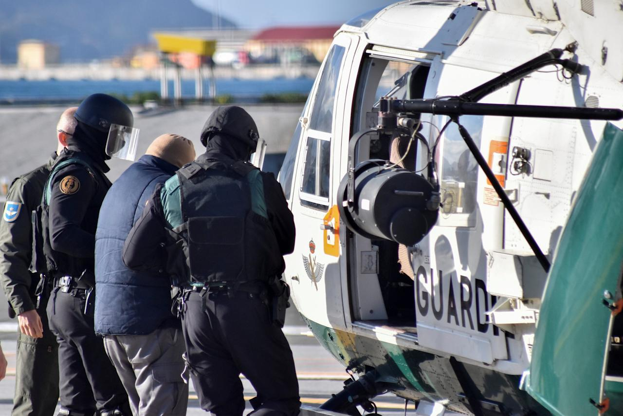 Spanish civil guards escort to a helicopter one of two suspects that were arrested and accused to have connections with Islamic militants, in Spain's North African enclave of Ceuta, January 13, 2017.   REUTERS/Jose Antonio Sempere          FOR EDITORIAL USE ONLY. NO RESALES. NO ARCHIVES.     TPX IMAGES OF THE DAY
